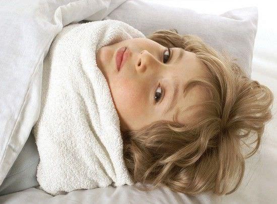Ребенок с компрессом